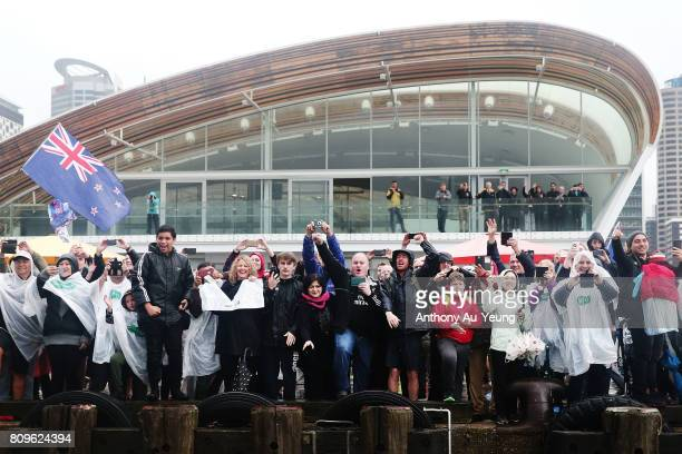 Team New Zealand fans show their support during the Team New Zealand Americas Cup Welcome Home Parade on July 6 2017 in Auckland New Zealand