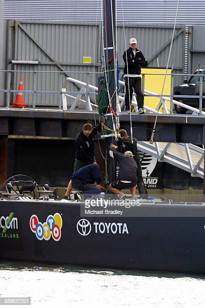 Team New Zealand members remove the broken mast from the America's cup yacht NZL 57 The mast broke during training early this afternoon on the...