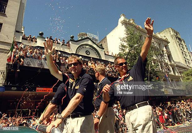 Team New Zealand members wave to the thousands of fans who turned out for their victory parade down Queen Street following their win over Prada in...