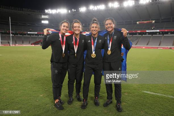Team New Zealand players celebrate with their gold medals after the Women's Rugby Sevens Medal Ceremony on day eight of the Tokyo 2020 Olympic Games...