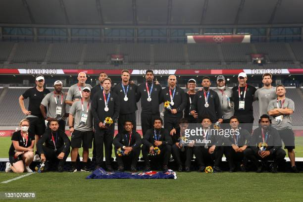Team New Zealand pose for photographs after the Rugby Sevens Men's Gold Medal match between New Zealand and Fiji on day five of the Tokyo 2020...