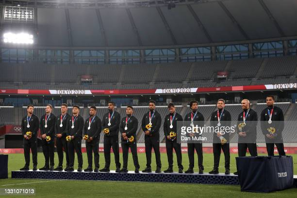 Team New Zealand pose with silver medals after the Rugby Sevens Men's Gold Medal match between New Zealand and Fiji on day five of the Tokyo 2020...