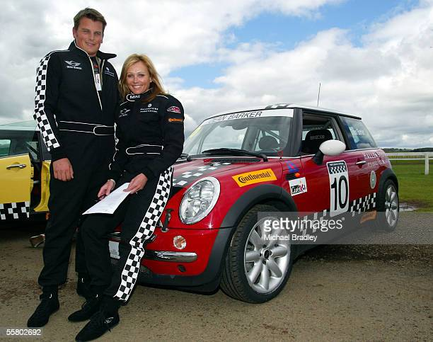 Team New Zealand Skipper Dean Barker and partner ex Black Sticks player Mandy Smith pose for a photo next to Dean's racing car as they and other...