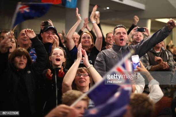 Team New Zealand supporters celebrate as they watch the racing at the Royal New Zealand Yacht Squadron as Team New Zealand win the Americas Cup over...