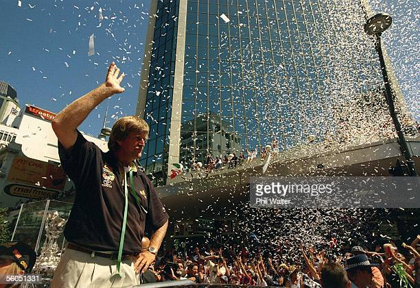 Team New Zealand's Sir Peter Blake is showered by ticker tape from the thousands of fans who turned out for their victory parade down Queen Street...