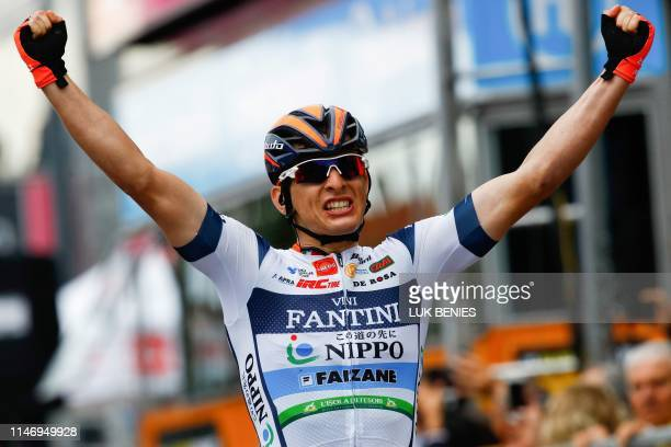 Team Nippo Vini Fantini Faizane' Italian rider Damiano Cima celebrates as he finishes first in the 18th stage of the 2019 Giro d'Italia, the cycling...
