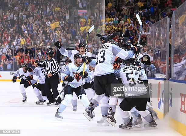 Team North America celebrates after an overtime goal on Team Sweden during the World Cup of Hockey 2016 at Air Canada Centre on September 21 2016 in...