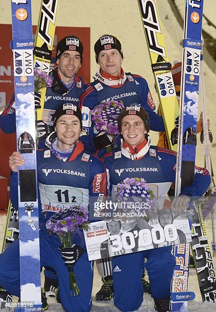 Team Norway Anders Bardal Anders Jacobsen Rune Velta and Anders Fannemel celebrate victory of FIS Ski Jumping World Cup Large Hill Team competition...
