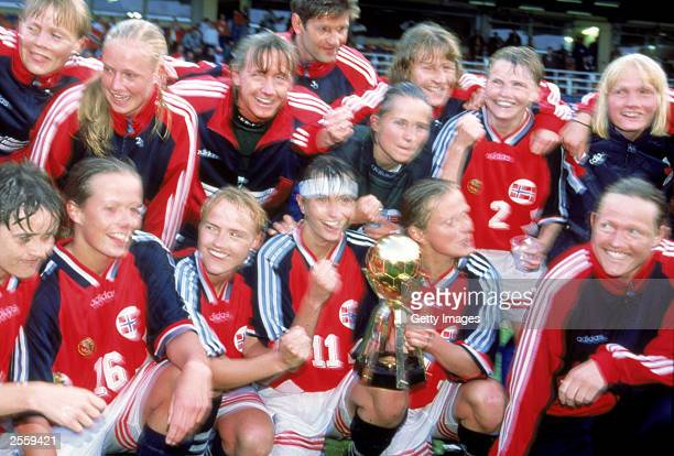 Team Norway celebrate their 20 victory over team Germany during the Women's World Cup