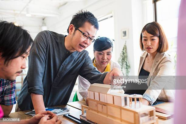 Team of architects having a meeting