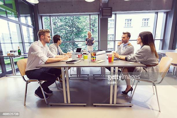 team of architects having meeting in office - real estate office stock photos and pictures