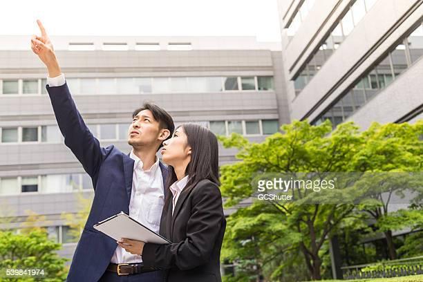 team of architects inspecting the new office buildings - coo bildbanksfoton och bilder