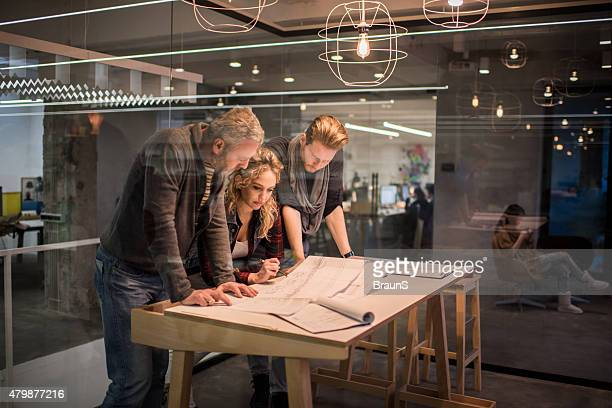 team of architects working on a new business projects. - architect stockfoto's en -beelden