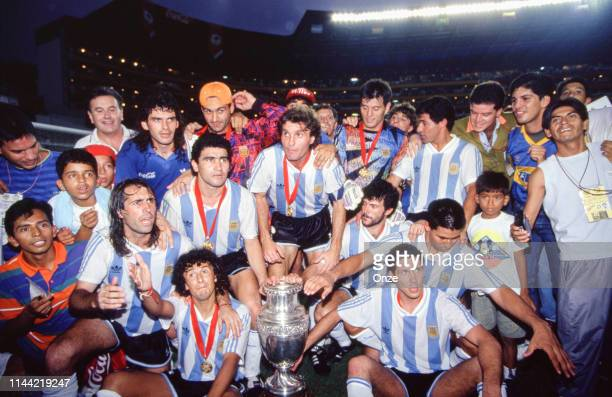 Team of Argentina celebrate the victory with the trophy during the final of Copa America 1993, between Argentina and Mexico, on July 04th in Estadio...