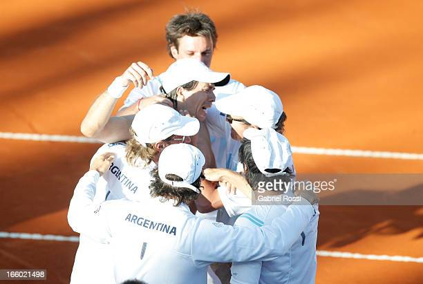 Team of Argentina celebrates after the fiveth match between Argentina and France in the queterfinal round of Copa Davis at the Parque Roca Stadium on...