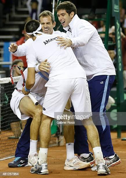 Team of Argentina celebrates after winning a quarter final doubles match between Carlos Berlocq / Leonardo Mayer and Viktor Troicki / Nenan Zimonjic...