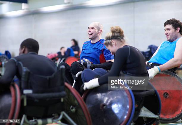 team of athletes enjoying wheelchair rugby - team sport stock pictures, royalty-free photos & images