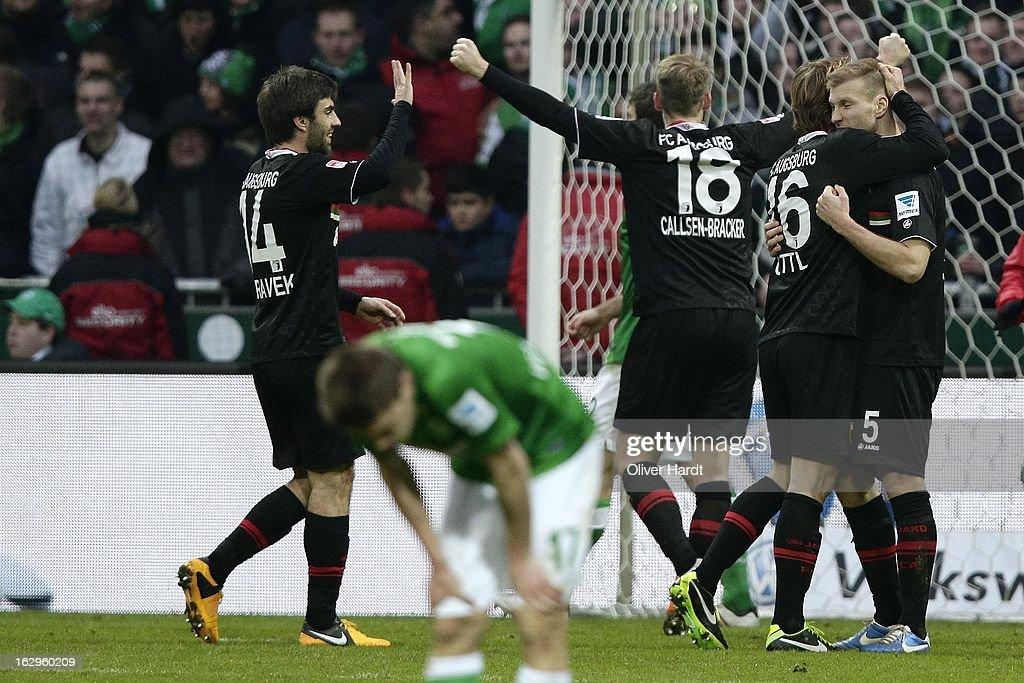 Team of Augsburg celebrate after the Bundesliga match between SV Werder Bremen and FC Augsburg at Weser Stadium on March 2, 2013 in Bremen, Germany.