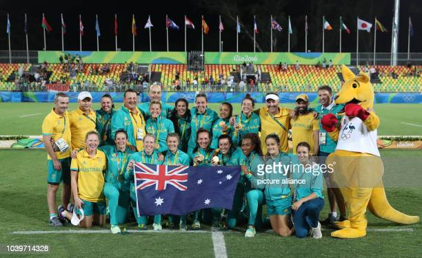 Team of Australia celebrate after winning the women's Rugby Sevens gold medal match between Australia and New Zealand at the Rio 2016 Olympic Games...