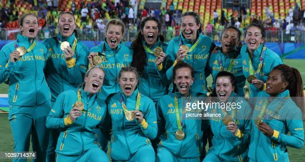 Team of Australia celebrates after winning the women's Rugby Sevens gold medal match between Australia and New Zealand at the Rio 2016 Olympic Games...