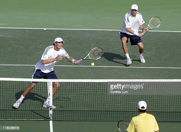 US team of Bob and Mike Bryan playing Victor Hanescu and Horia Tecau of Romania during the 2006 Davis Cup at the La Jolla Beach and Tennis Club in...