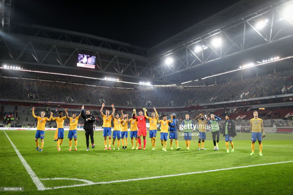 Team of Braunschweig celebrate after the Second Bundesliga match between Fortuna Duesseldorf and Eintracht Braunschweig at Esprit-Arena on March 13, 2017 in Duesseldorf, Germany.