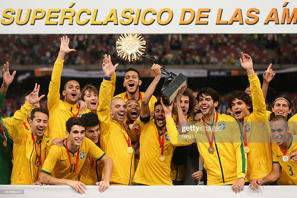 Team of Brazil celebrates winning Super Clasico de las Americas between Argentina and Brazil at Beijing National Stadium on October 11, 2014 in Beijing, China.