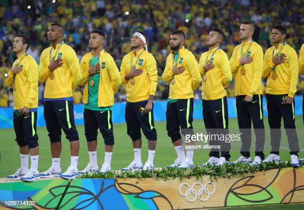 Team of Brazil during the medal ceremony after the Men's soccer Gold Medal Match between Brazil and Germany during the Rio 2016 Olympic Games at the...