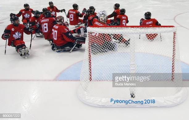 Team of Canada celebrate the victory over Sweden in the Ice Hockey Preliminary Round Group A game between Canada and Sweden during day one of the...