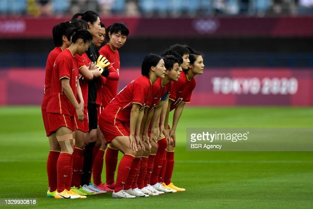Team of China line up for a teamphoto during the Tokyo 2020 Olympic Football Tournament match between China and Brazil at Miyagi Stadium on July 21,...