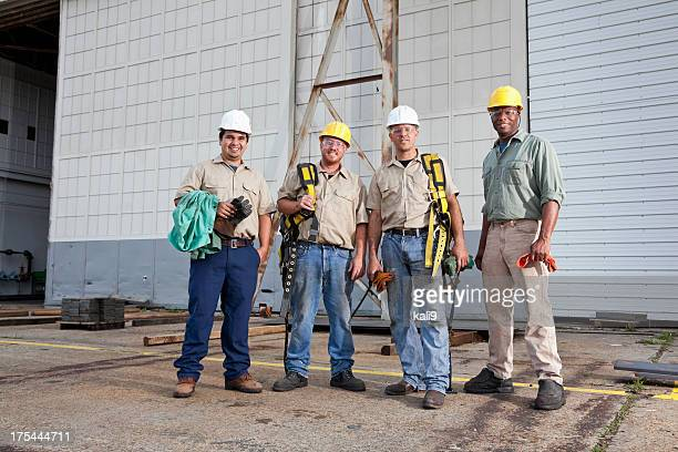 Team of construction workers with harnesses