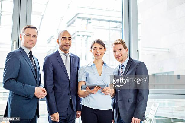 Team of corporate professionals together in office