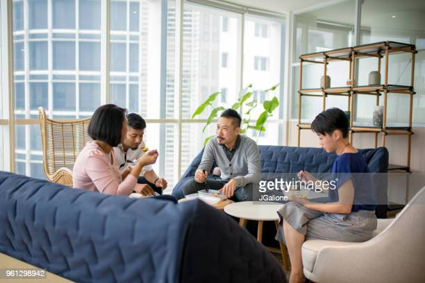 Team of coworkers having a meeting over lunch