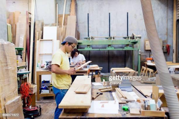 Team of craftspeople working in their workshop