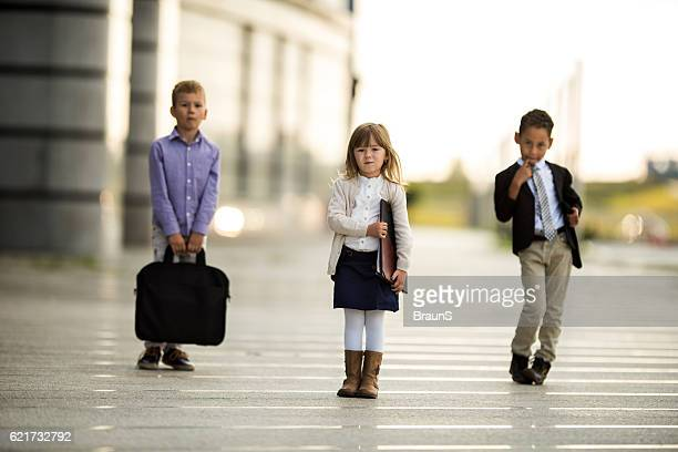 team of cute business kids in smart casual clothing outdoors. - vestuário de trabalho - fotografias e filmes do acervo