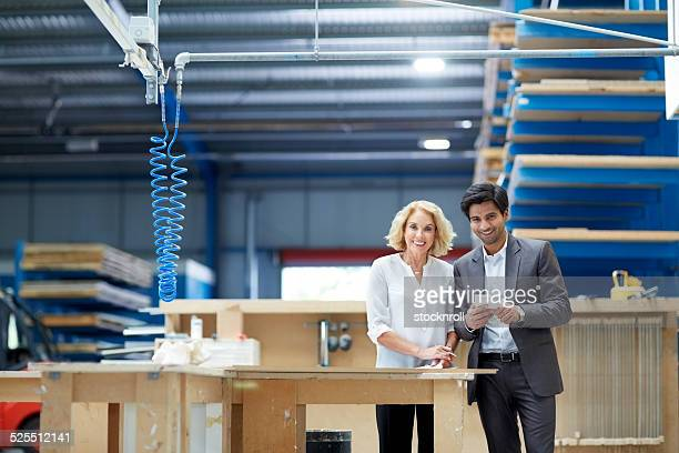 Team of dedicated businesspeople at factory shopfloor