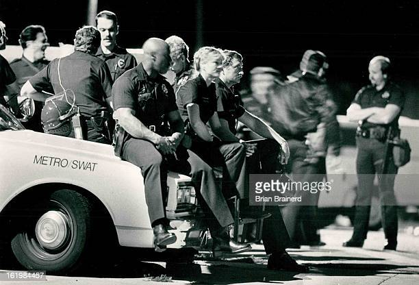 81986 A team of Denver police including SWAT Juvenile Prevention and Tactical was bored but happy as they stood by at 27th and 8i California night 2...