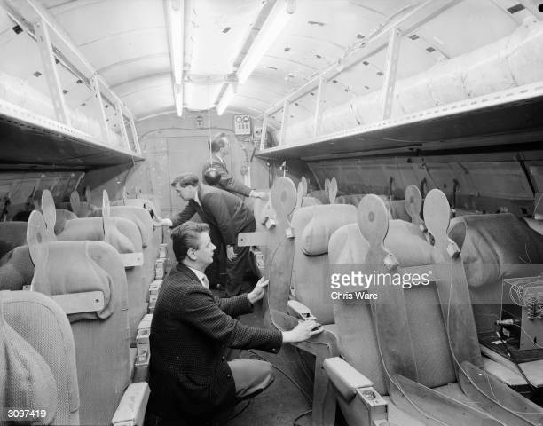 Team of designers examining the interior of Concorde, April 1964.