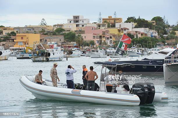 A team of divers leaves the Lampedusa harbour on October 6 2013 before operations to recover bodies from the shipwreck that sank two days ago Italy...