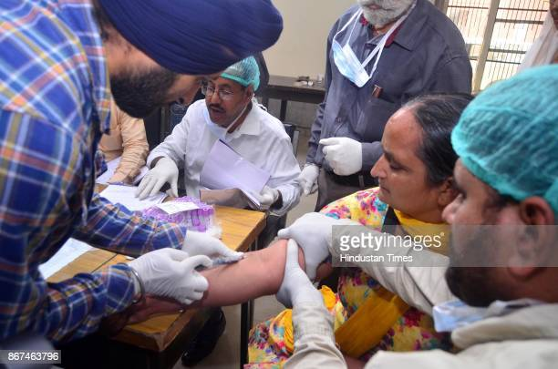 A team of doctors collecting blood samples of Gurmeet kaur whose Brother Gurcharan Singh missing in Iraq at Forensic lab of Government Medical...