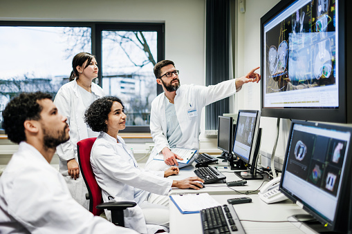 Team Of Doctors Looking At Lab Results - gettyimageskorea