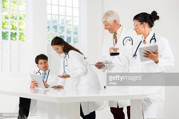 Team of doctors working in laboratory