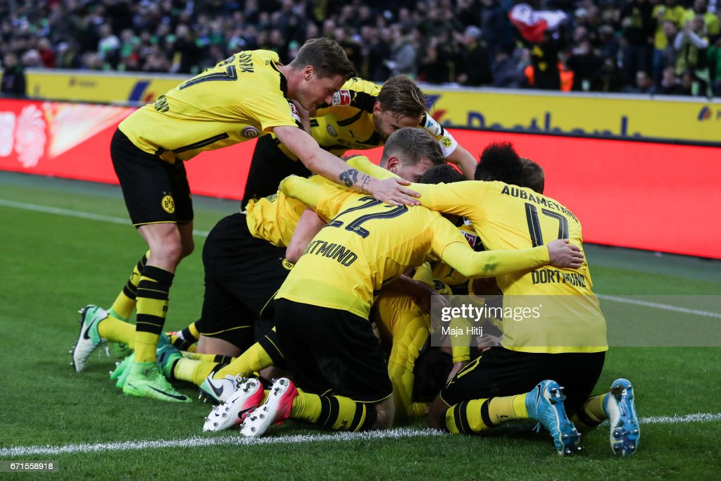Team of Dortmund celebrates after scoring a goal to make it 2-3 during the Bundesliga match between Borussia Moenchengladbach and Borussia Dortmund at Borussia-Park on April 22, 2017 in Moenchengladbach, Germany.