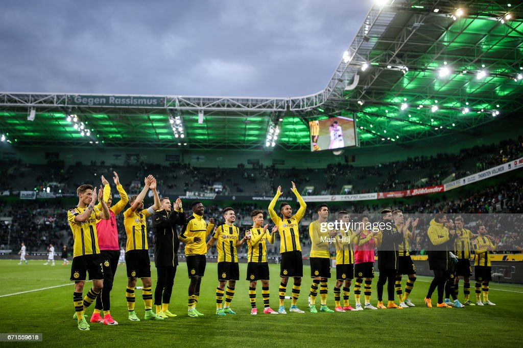 Team of Dortmund celebrates after the Bundesliga match between Borussia Moenchengladbach and Borussia Dortmund at Borussia-Park on April 22, 2017 in Moenchengladbach, Germany.