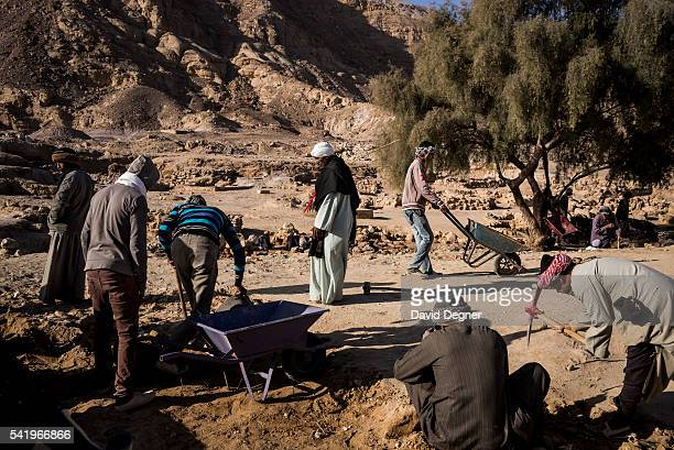 A team of egyptian excavators carefully dig at the site of a pharaonic era port on the red sea on January 29 2015 in Ain Sukhna The team comes mainly...