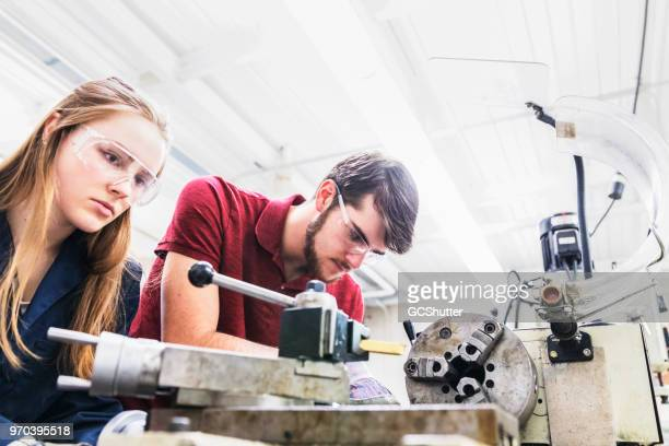 Team of engineering students working at a science lab