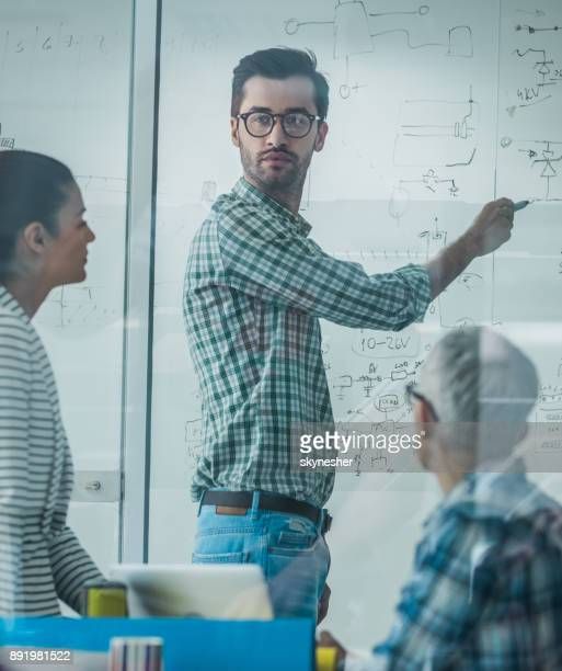 team of engineers making a business strategy on a business meeting in the office. - small group of people stock pictures, royalty-free photos & images