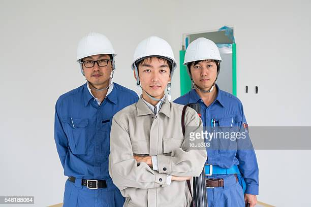 Team of engineers or architects at a building construction site