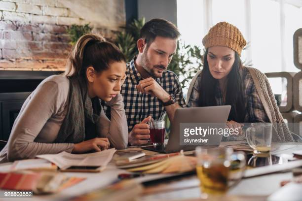 team of entrepreneurs reading an e-mail on laptop in the office. - surfing the net stock photos and pictures