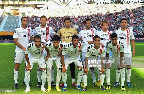 Team of Estudiantes de la Plata pose for a photo before a match between Estudiantes and Atletico Rafaela as part of round 7 of Torneo Final 2014 at...